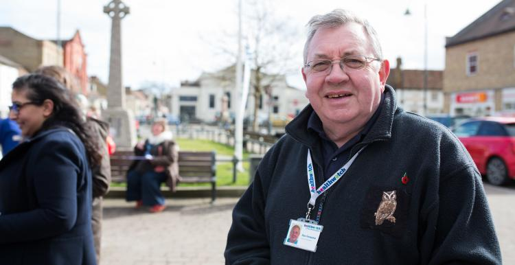 Man standing outside with a Healthwatch lanyard