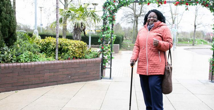 Woman smiling using walking aid
