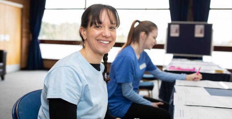 Woman smiling at desk