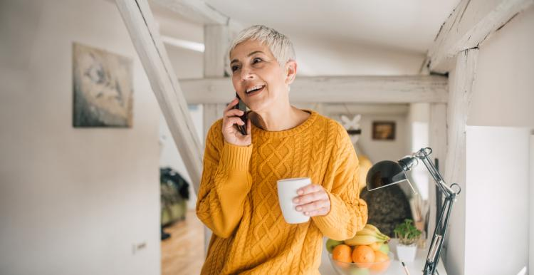 Woman with short blonde hair on the phone