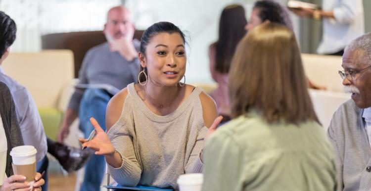 Woman discusses ideas during meeting