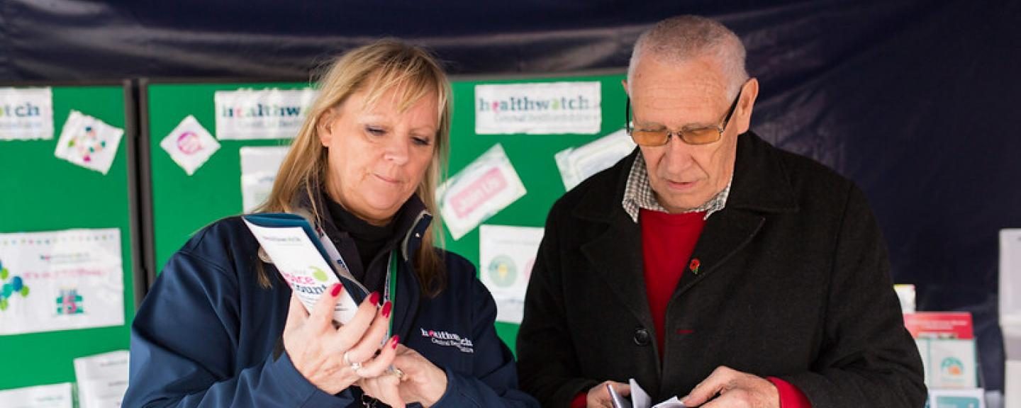 Healthwatch volunteer stood with a member of the public