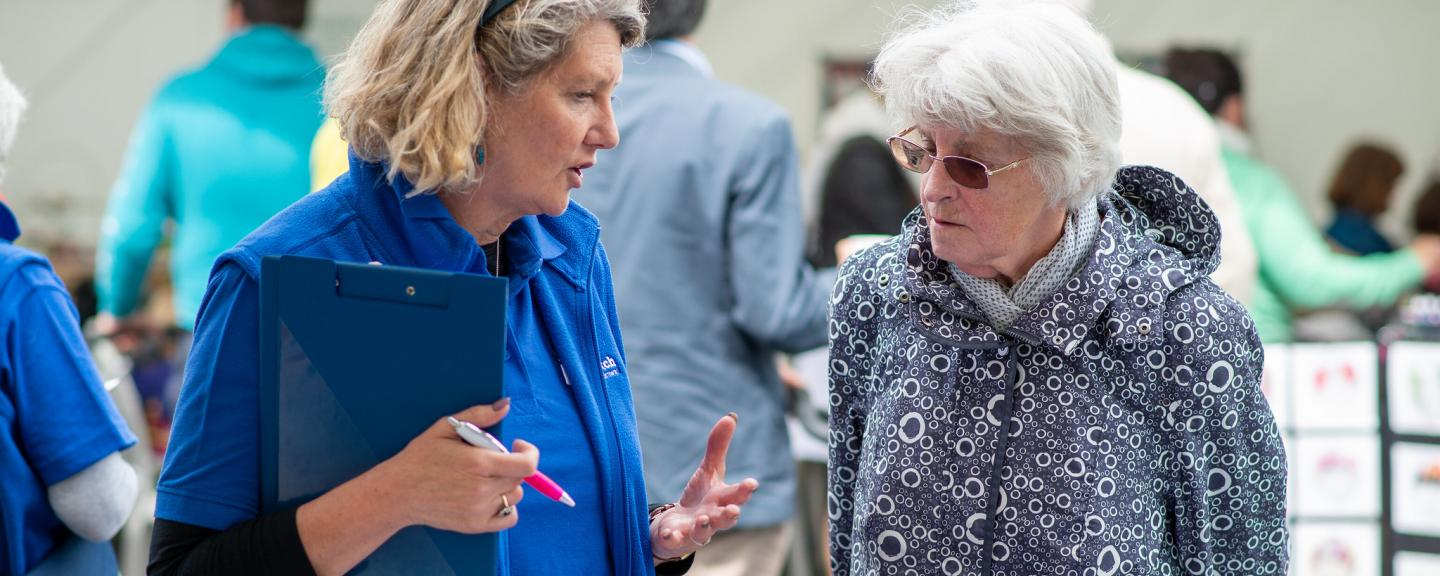 Two women talking at a county show