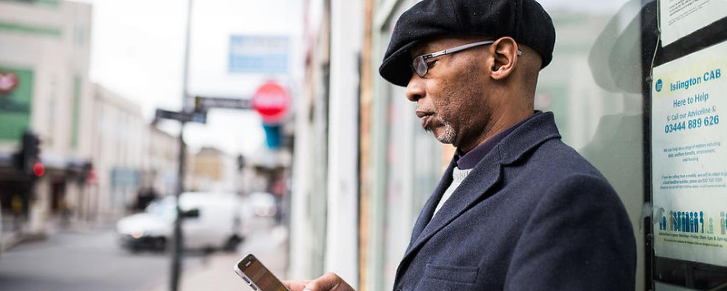 A man standing outside on his phone