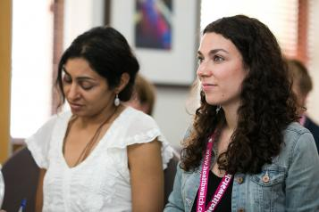 Two women at Healthwatch conference learning