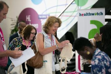 Healthwatch staff registering at an event.