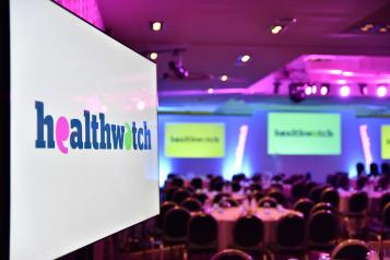 Healthwatch conference screen with logo.