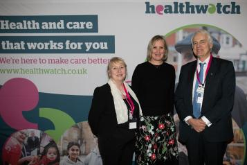 Imelda Remond, Caroline Dineage and Sir Robert Francis in from of Healthwatch sign.