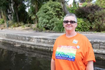 A woman wearing a pride t-shirt