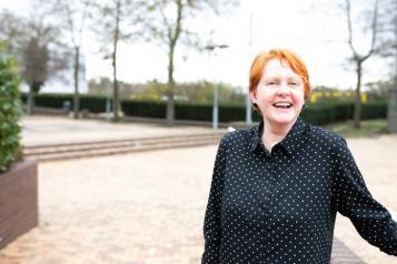 Woman outside smiling