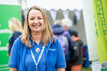 A Healthwatch Cornwall volunteer smiling at the camera