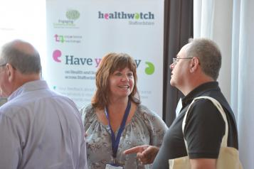 Two Healthwatch colleagues talking to one another