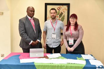 Three people from the healthwatch network smiling.