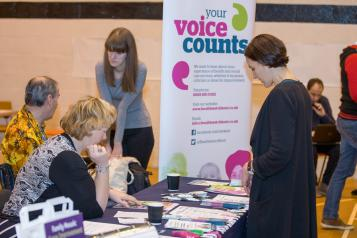 Local Healthwatch in action at an community event gathering people's experiences.