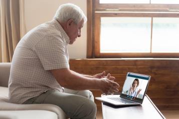 Man speaking to a GP online