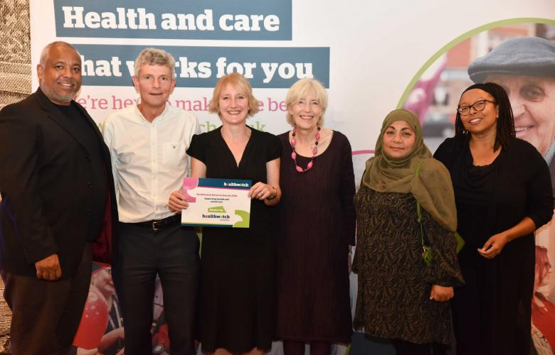 Six members of local Healthwatch holding up a runners up certificate from the Healthwatch network awards.
