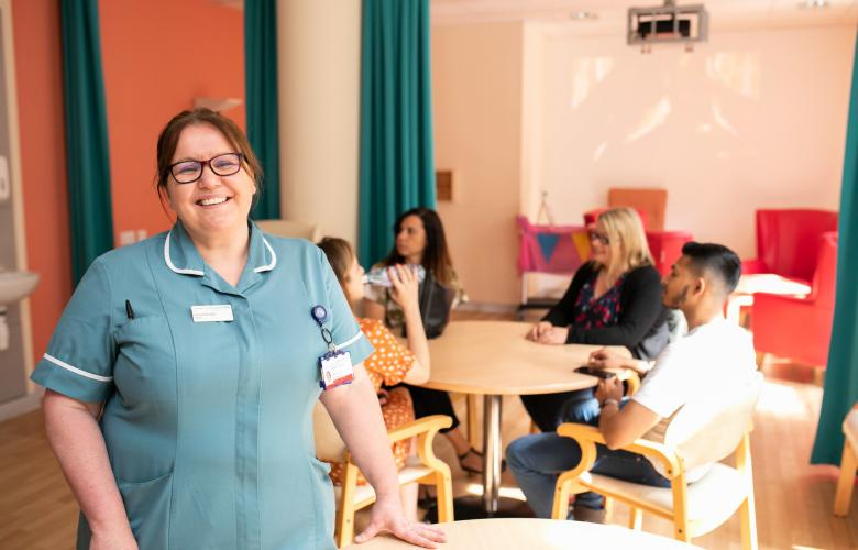 A nurse smiling in a care home
